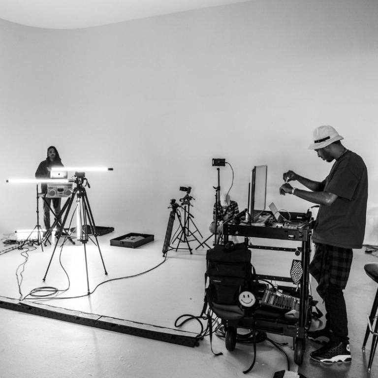 two men DJing