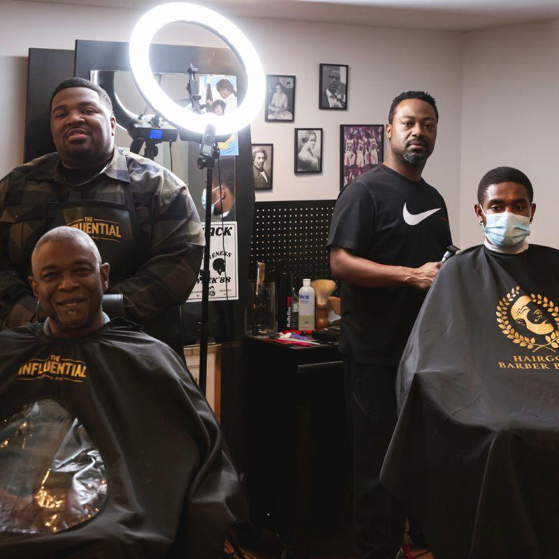 barbers cutting hair