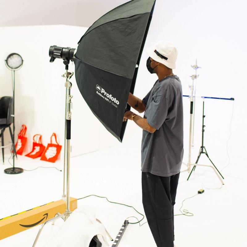 man adjusting light